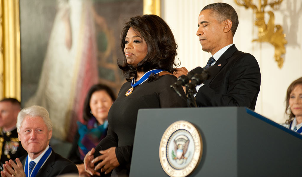 Oprah Receiving A Medal and Award from Barack Obama